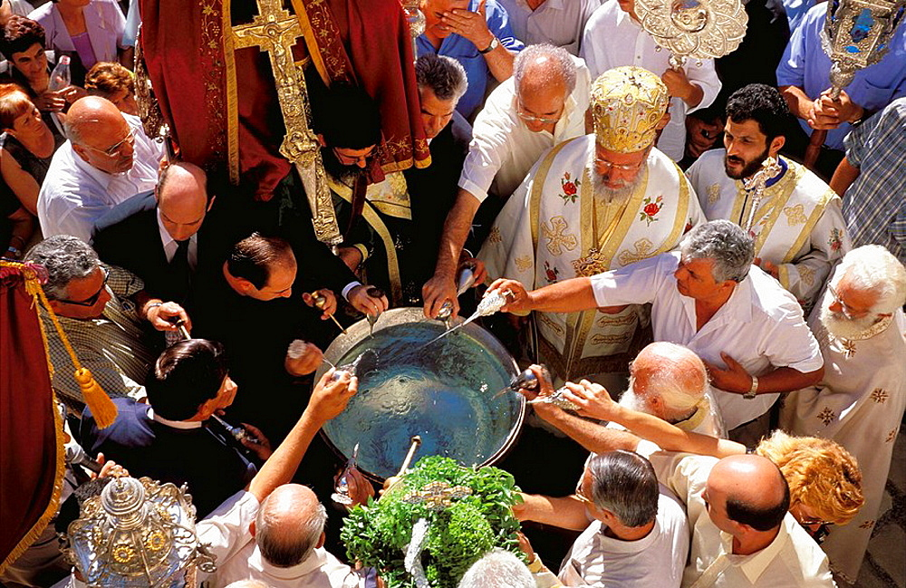 Devotees pouring rose essence into holy water during festival of the Holy Cross, Monastery of the Holy Cross, Omodhos, Cyprus