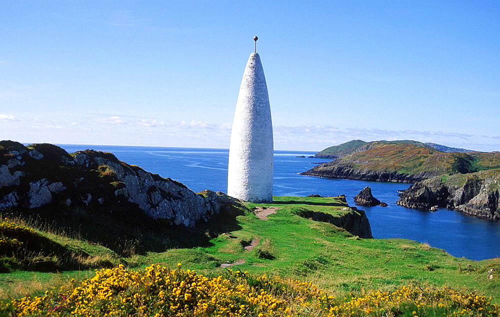White navigation beacon at entrance to Baltimore harbour, County Cork, Ireland