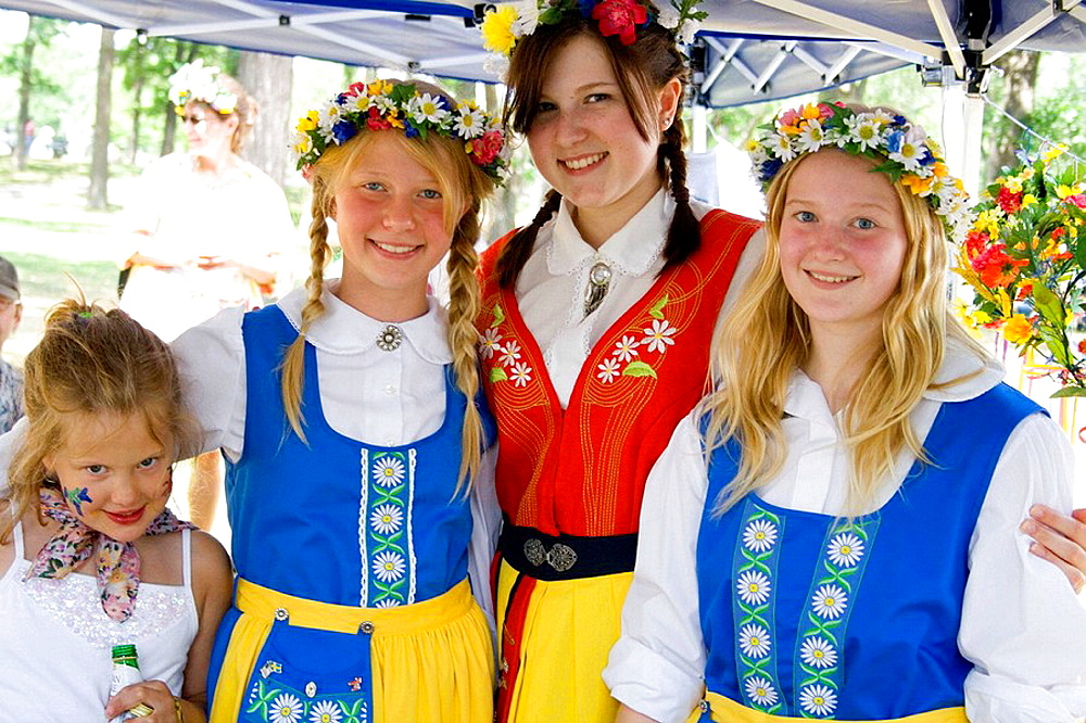 Four girls in traditional Swedish costumes  Svenskarnas Dag Swedish Heritage Day Minnehaha Park Minneapolis Minnesota USA