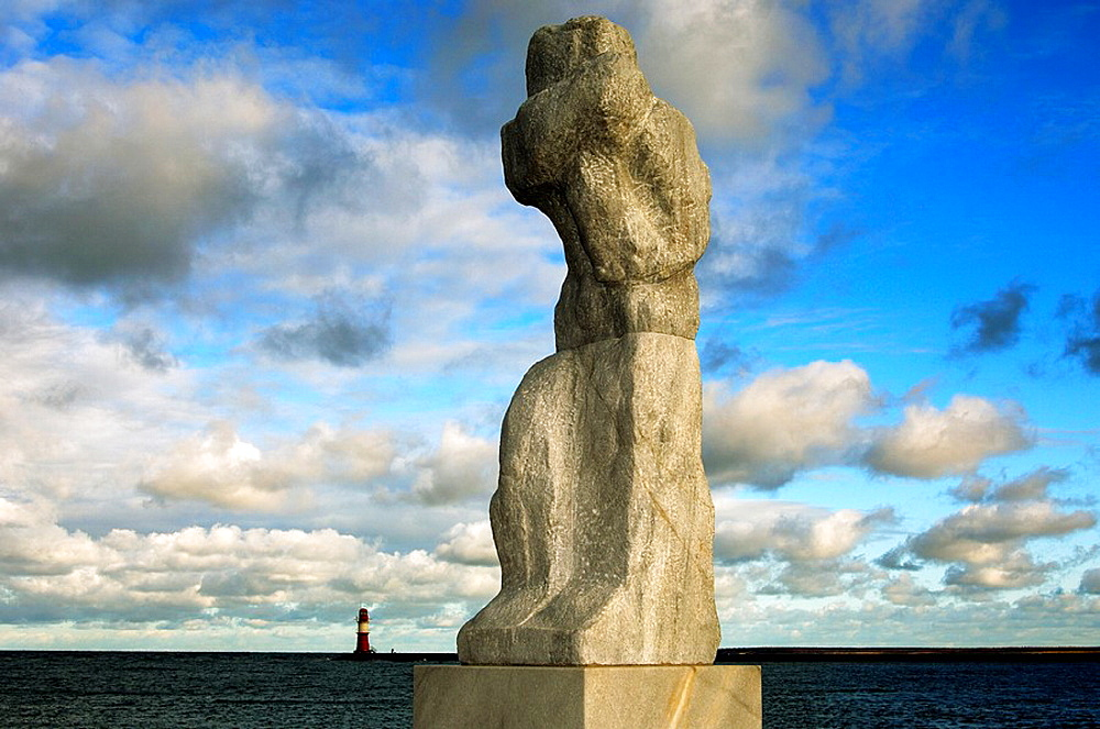 Grosse Stehende, The big standing, sculpture of a mourning sailors wife by Werner Stoetzer along the Mole quai, Rostock-Warnemuende, Mecklenburg-Western Pomerania, Germany