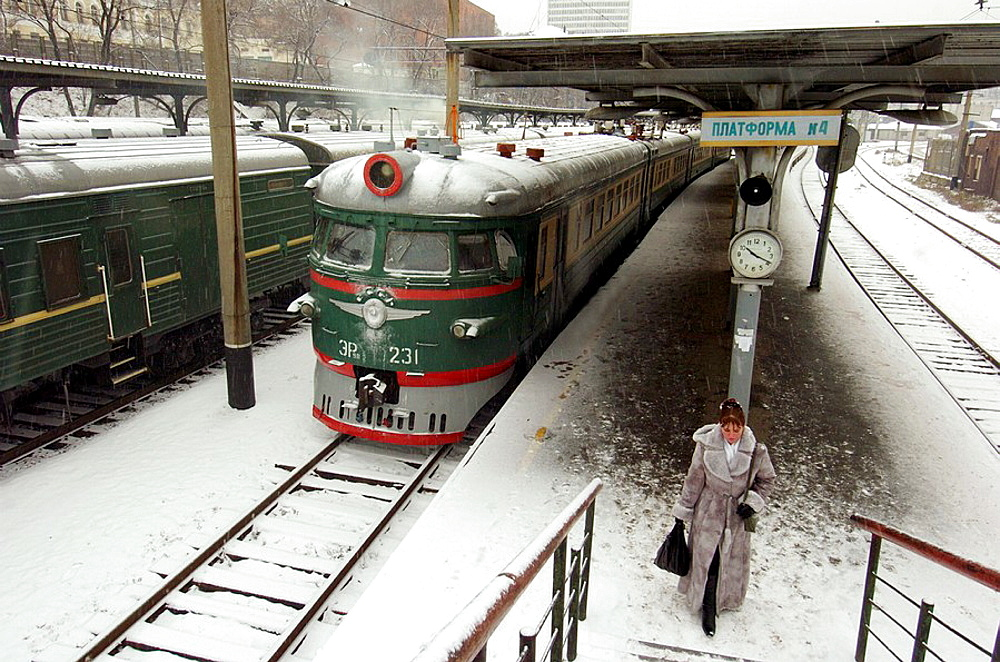 Woman on platform of Vladivostok railway station during winter in Russian Far East