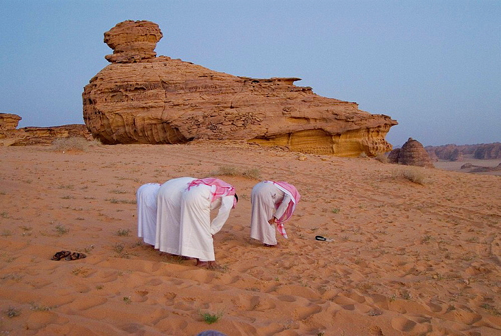 Saudi Arabia, Al Ula, desert near the oasis, evening prayer