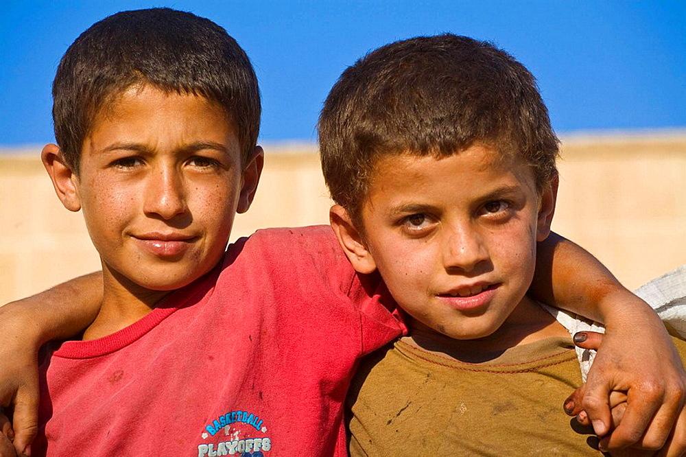 Turkey, Anatolia, Sanliurfa (aka Urfa, the Prophets city), Golbasi, Two street boys
