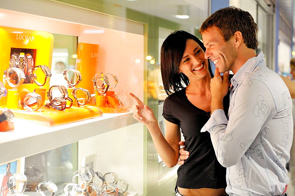 Married couple in front of the jewelry. - 817-226815