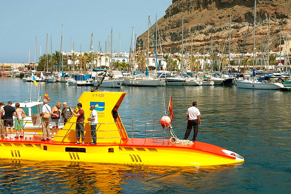 Yellow tourist submarine in Puerto de Mogan on Gran Canaria in The Canary Islands.