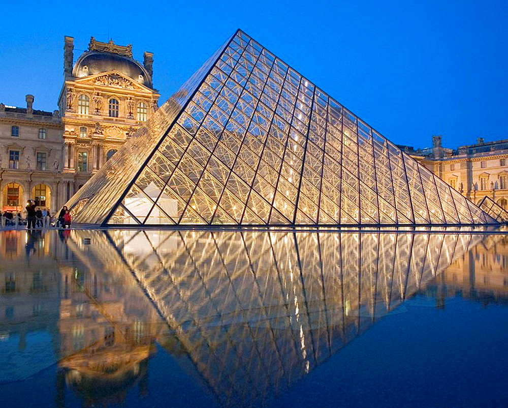 The new entrance to the Musee du Louvre, a pyramidal, glass structure designed by renowned American architect I M Pei  Paris, France