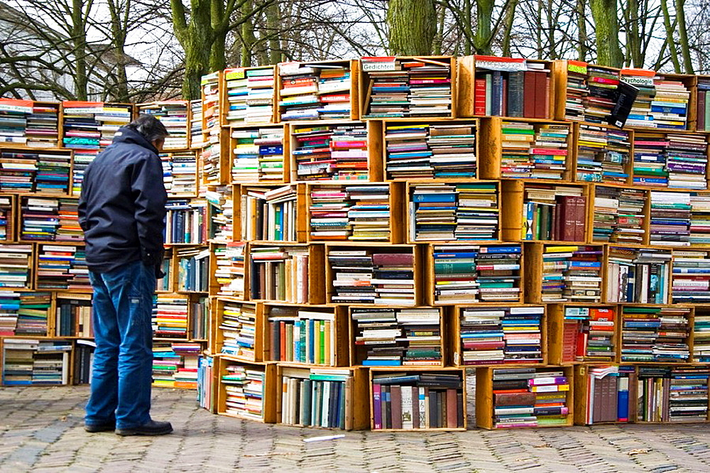 A man looking for a book on the street
