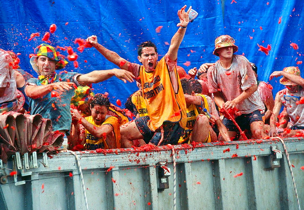 Revellers throw tomatoes from a truck during the annual festival of La Tomatina  Bunol, Valencia, Spain