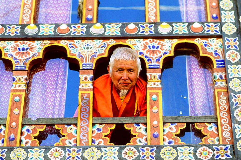 Old man in a typical window, Paro, Bhutan.