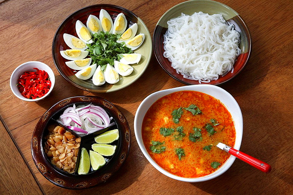 Myanmar, Burmese Mohinga fish soup with side dishes
