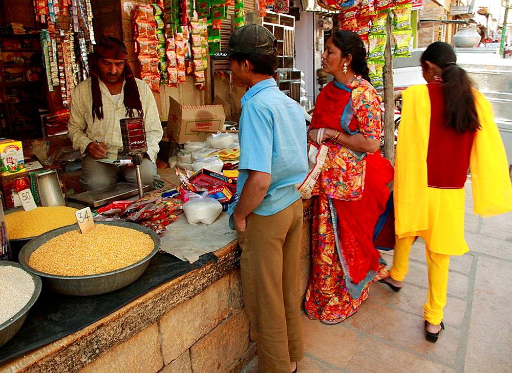 India, Rajasthan, Jaisalmer, street scene, shop, people