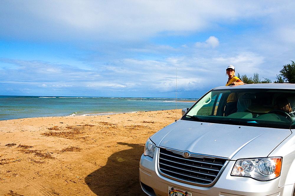 Girl checks out the surf in the distance, Hanalei Bay, Kauai, Hawaii, USA