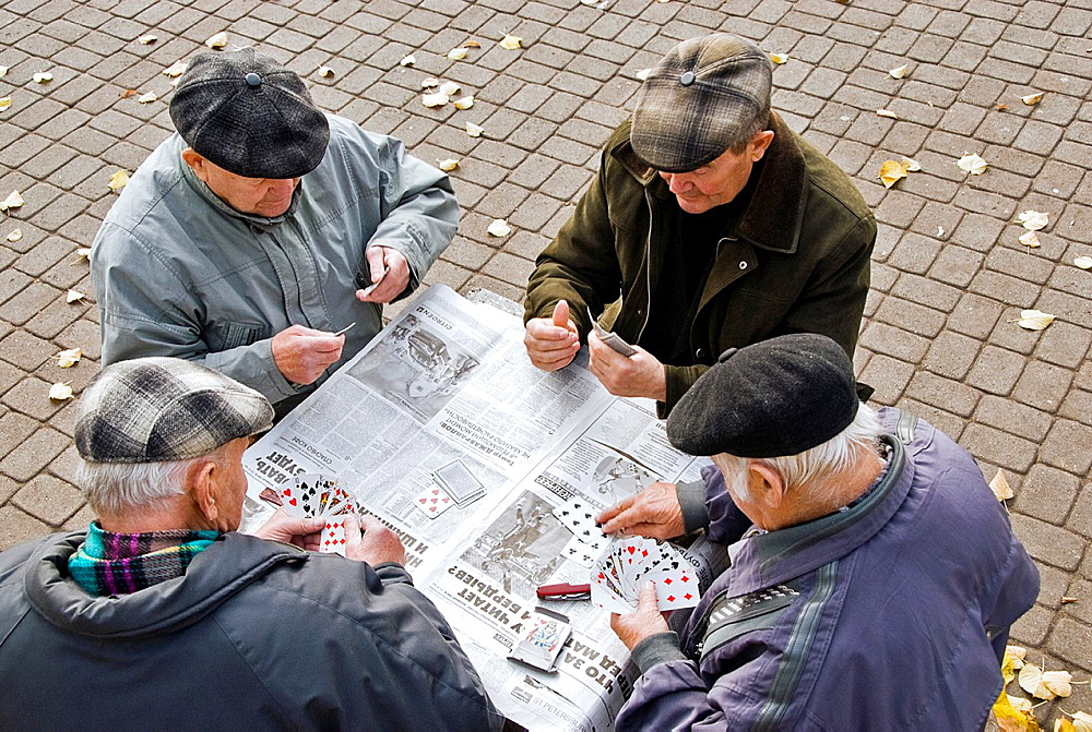 Group of old men playing cards in Wohrmanns Garden, Riga, Latvia, Europe
