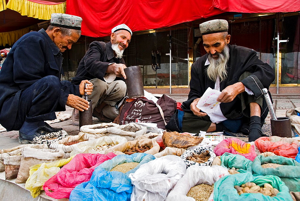 Group of traditional doctors preparing their recipes in the street Kashgar, Xinjiang, China