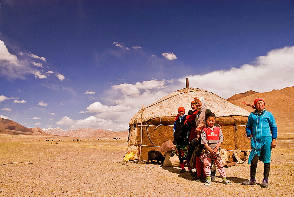 Tajik family near their yurt, Pamir highway, Tajikistan, Asia