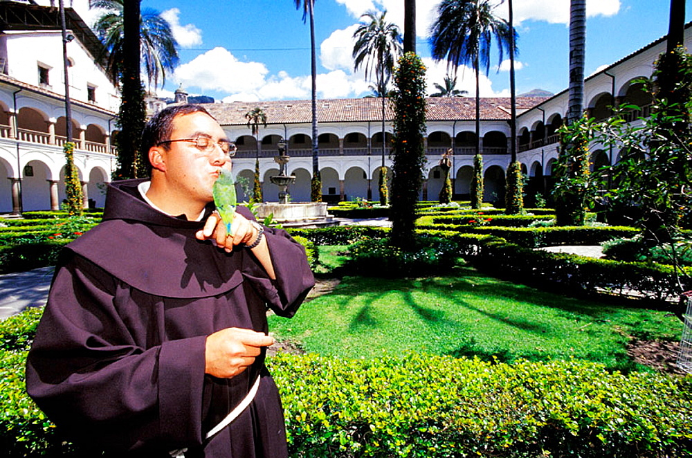 Monk and his parrot pet, Convento de Sant Francisco (Monastery and church founded in 1534 so that the oldest in Latin America), Quito, Ecuador