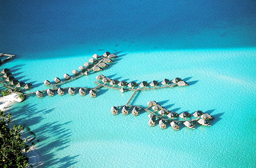 Aerial of luxury hotel huts built on piles on the lagoon, Bora Bora, Leeward Islands, French Polynesia - 817-26035