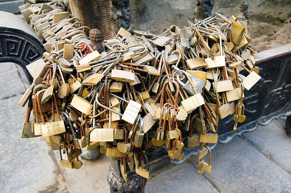 Tai Shan holy mountain, Shandong, China Couples seeking good fortune leave padlocks on incense stand at the South Heavenly Gate