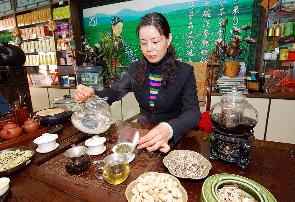 Tea merchant Lin Guang Xia serving fine Chinese green tea in headquarters of her tea shop chain Zibo, Shandong Province, China