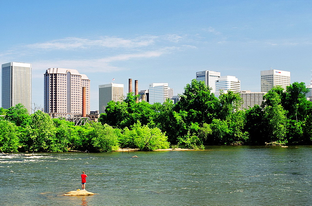 Richmond, the state capital city of the USA state of Virginia Man fishing in the James River in the foreground