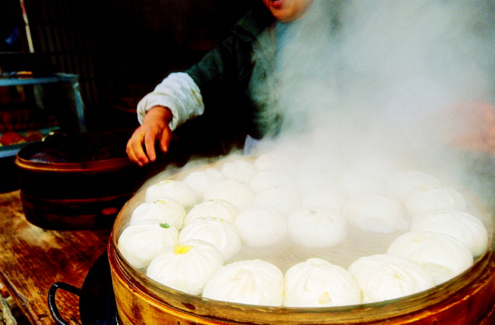 Cooking Dim Sum in a popular market by a canal, Suzhou, Kiangsu province, China