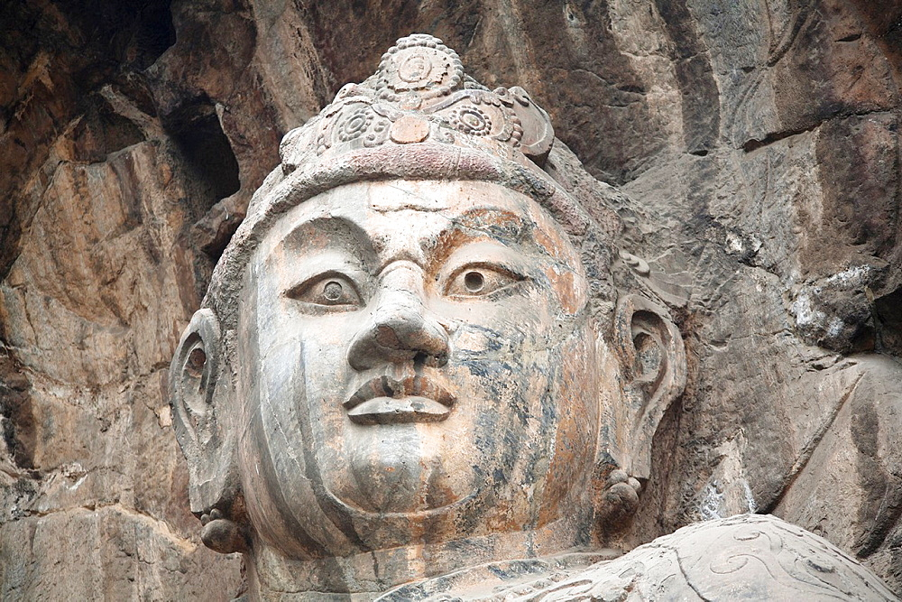 Carved Buddha statue, Fengxian Temple, Longmen Grottoes and Caves, Luoyang, Henan Province, China Tang Dynasty