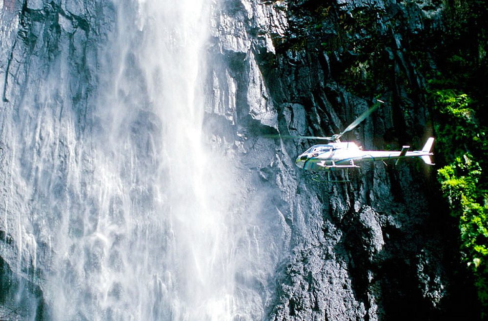 Helicopter by Trou de Fer cascading waterfall, Reunion Island (France)