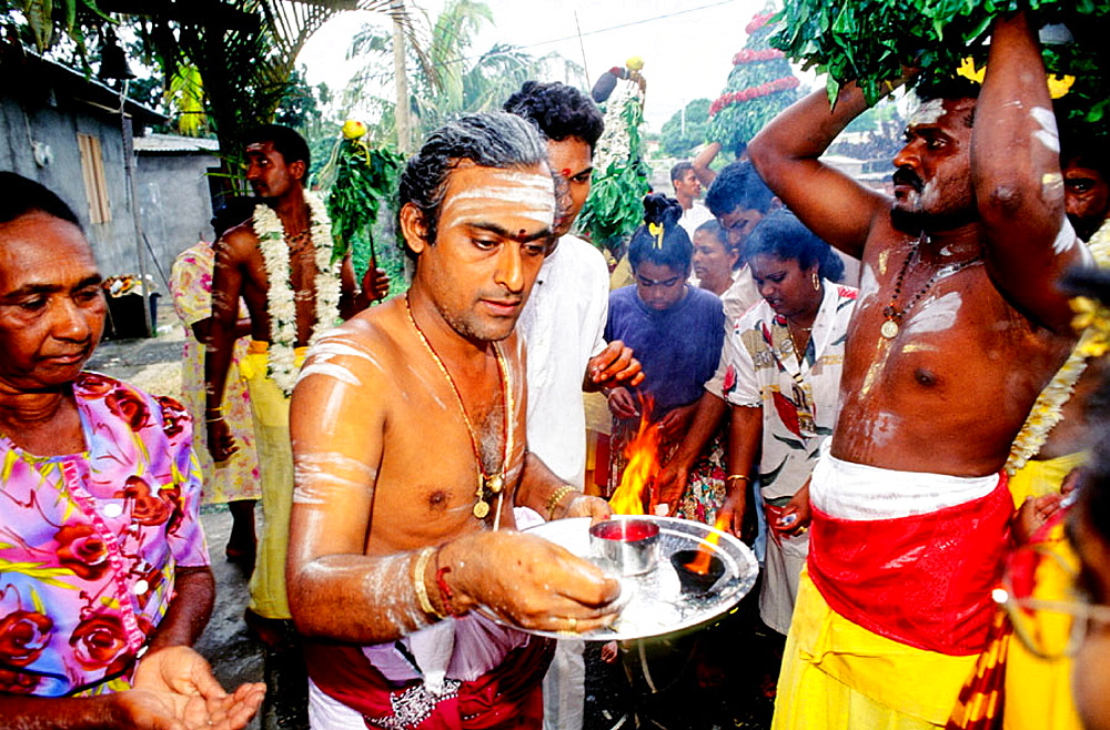 Tamil people performing hinduist ritual at St-Gilles-Les Hauts, Reunion Island (France)
