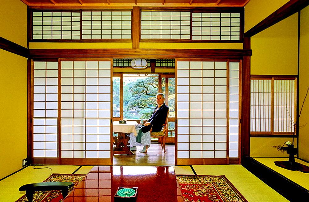 European visitor in a traditional riokan (ancient inn), City of Fukuoka, Kyushu Island, Japan.