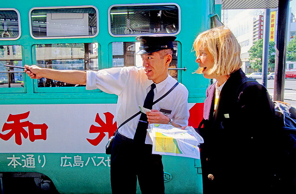 European woman asking for her way to a local policeman, Hiroshima, Japan.