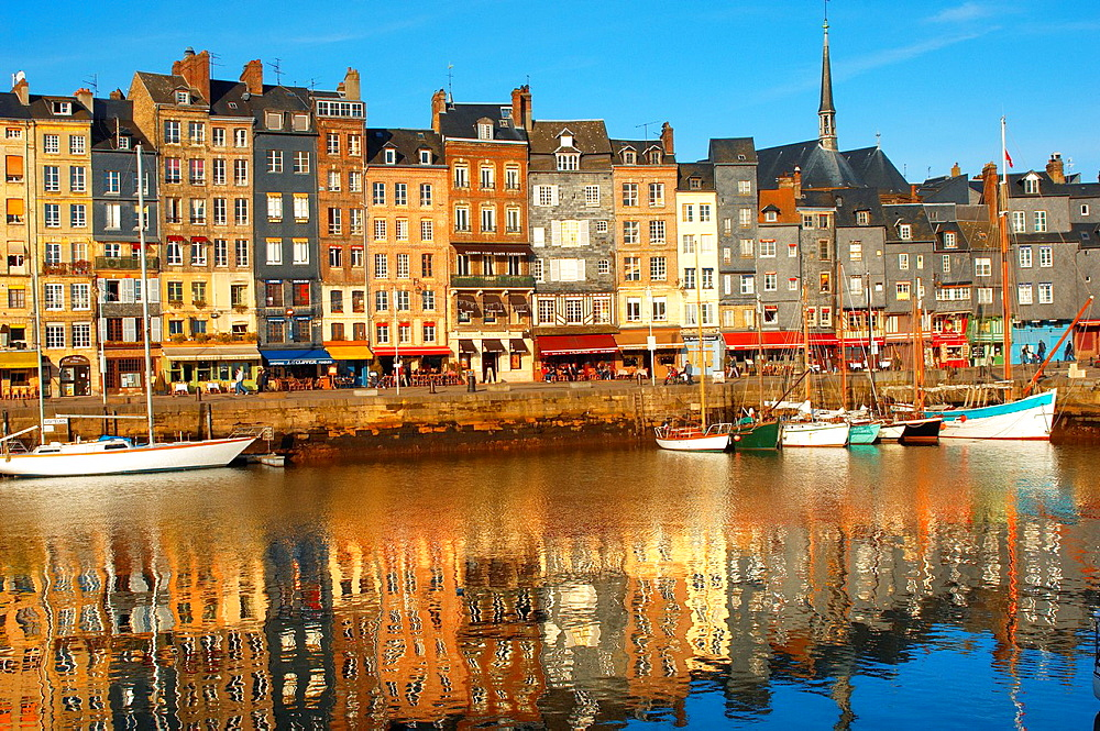 Reflection of harbour buildings and yaughts Honfleur, Normandy, France
