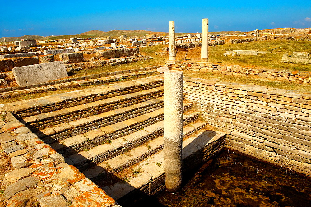 The Minoan Fountain in the ruins of the Greek city of Delos, the birthplace of the twin gods Apollo and Artemis Greek Cyclades Islands