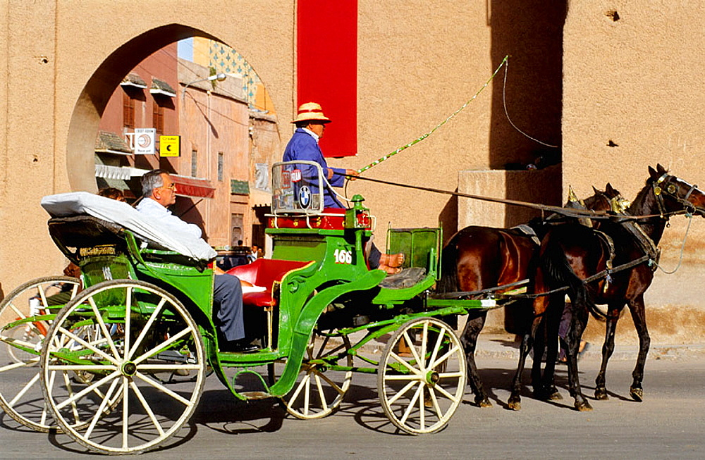 Barouche on the Jemaa El-Fna square, the liveliest place night and day in Marrakech, Morocco. - 817-26697