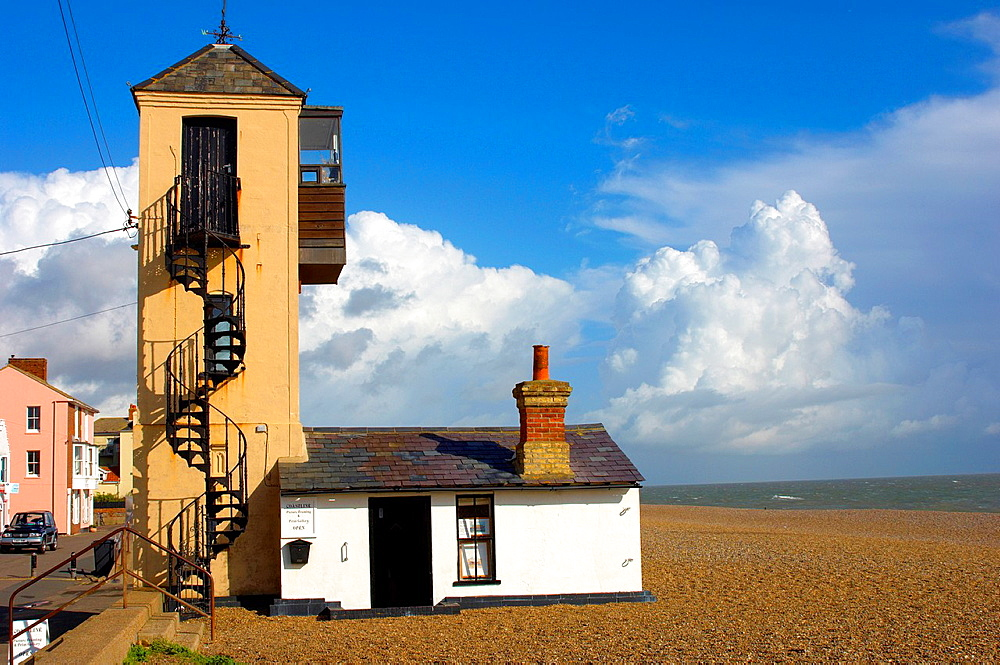 Brightly colored painted houses and fishermans lookout tower on the sea front beach at Aldeburgh, East Anglia, Suffolk, England