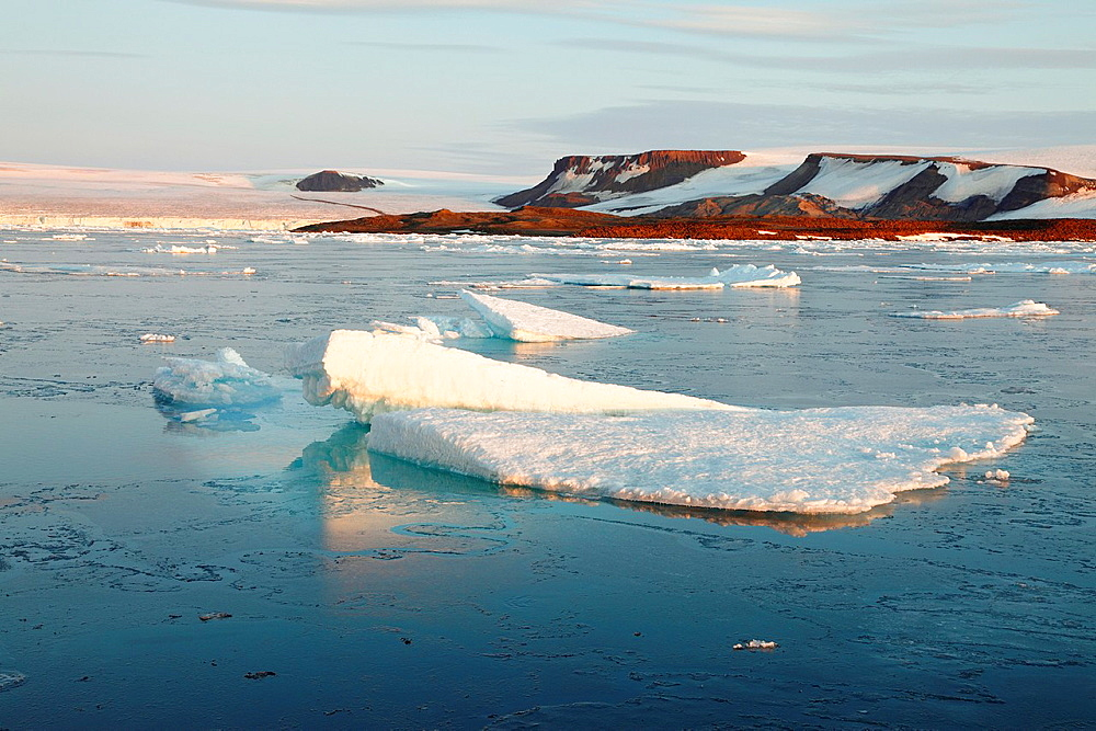 arctic landscape with ice floes in Arctic Ocean and mountains, Spitsbergen, Svalbard