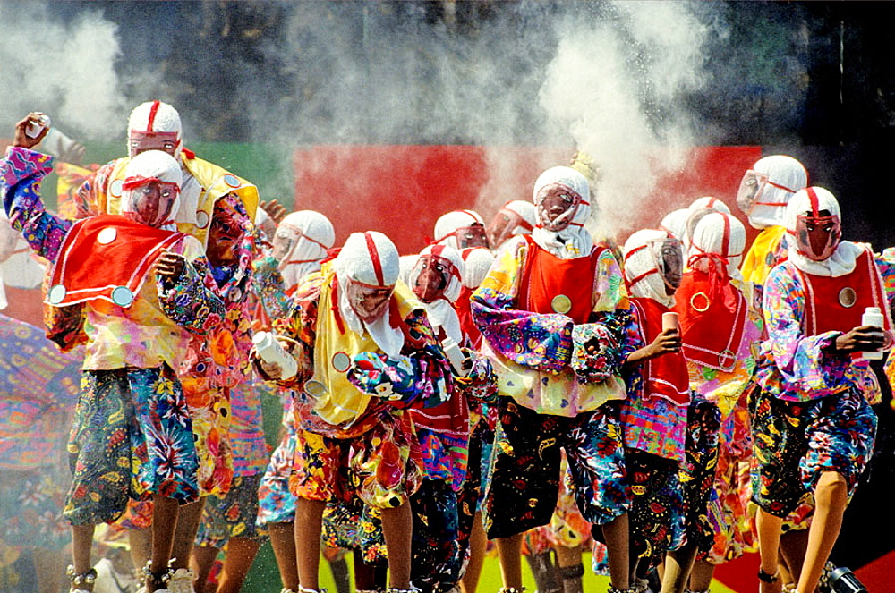 The pierrots are young boys wearing a special and traditional disguise who dance and enjoy throwing talcum powder to each others, Mardi-Gras parade, Grenada island, Caribbean - 817-26785