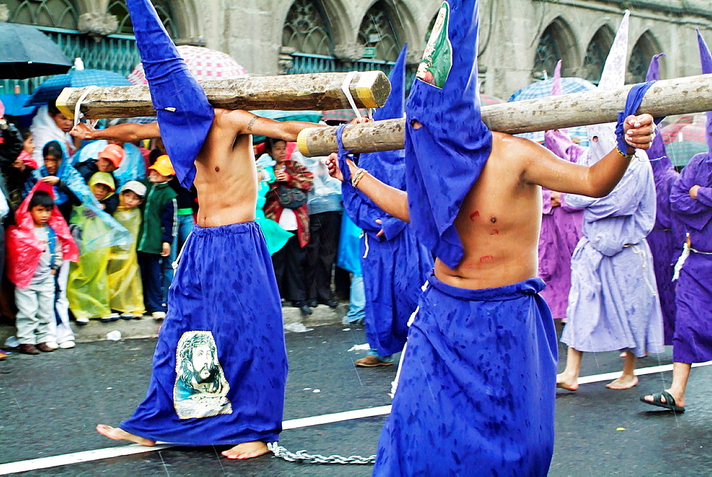 Hooded men at Easter procession in Quito, Ecuador - 817-269692