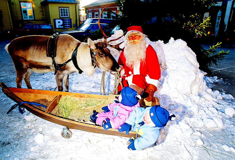 Santa Claus and his reindeer in the historic city of Poorvo (BorgÔæå), Scandinavia,Finland