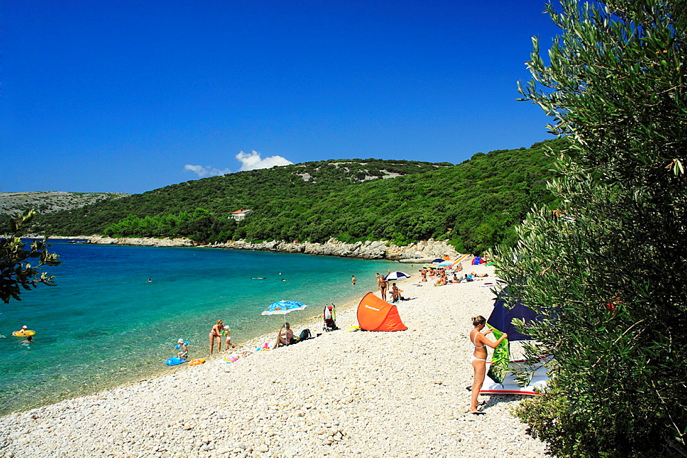 People on a beach in Ustrine village on Cres Island, Croatia