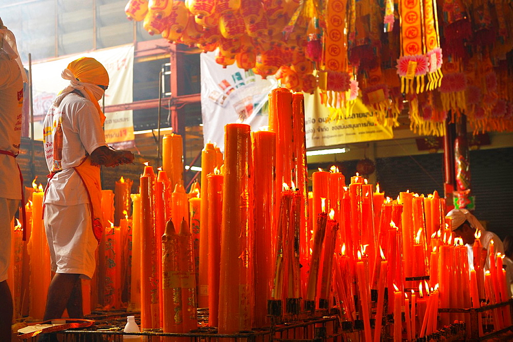 candles lighted for good luck and prosperity, Vegetarian festival at San Jao Sieng Kong shrine, wat sung heng yee, Chinatown, Bangkok,