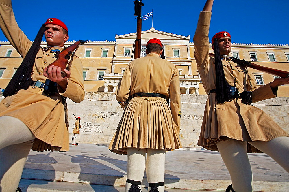 Soldiers evzones on guard at the Monument to the Unknown Soldier and Parliament Royal Palace, Syntagma Square, Athens Greece