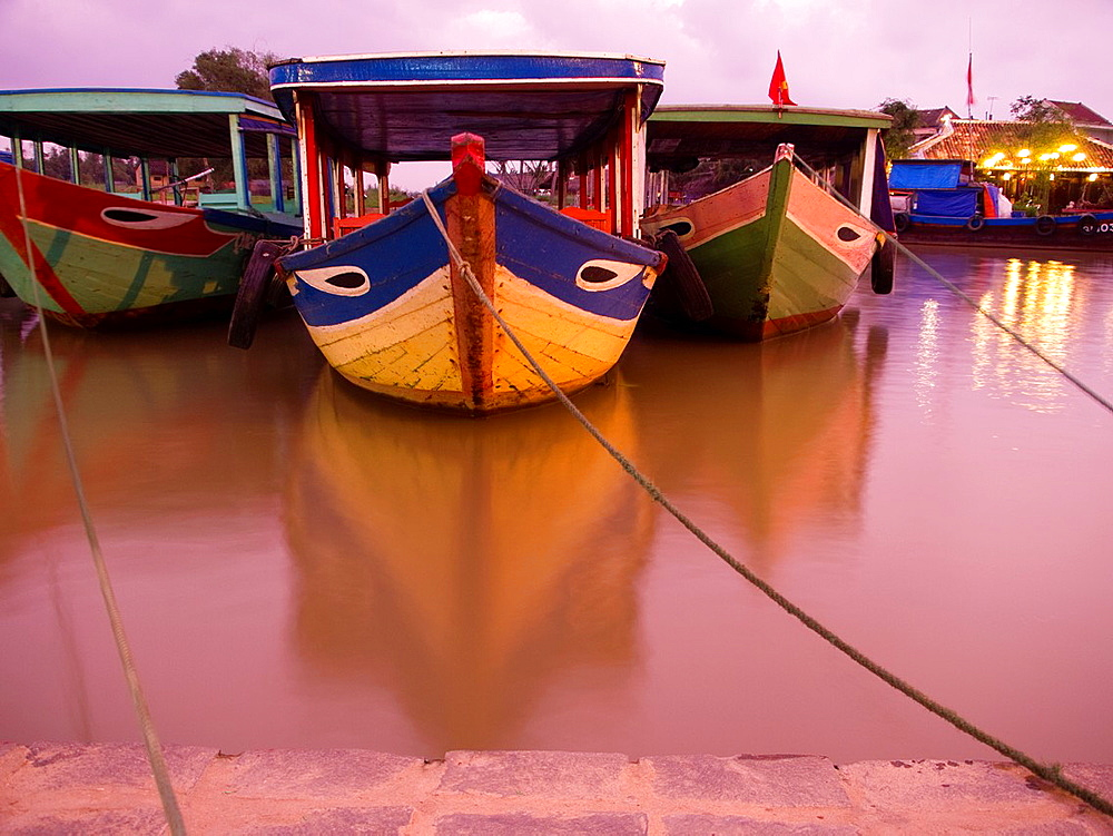 Boats in port in historic center of Hoi An, Vietnam