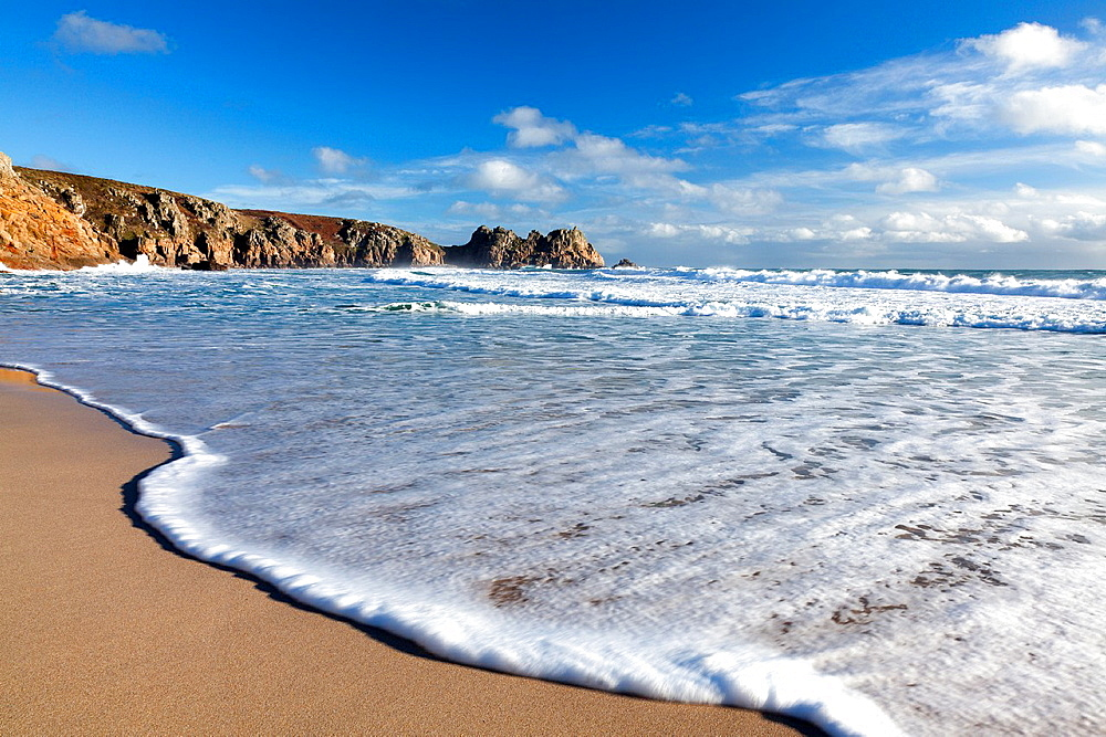 Waves on the beach at Porthcurno Cornwall England UK 2011