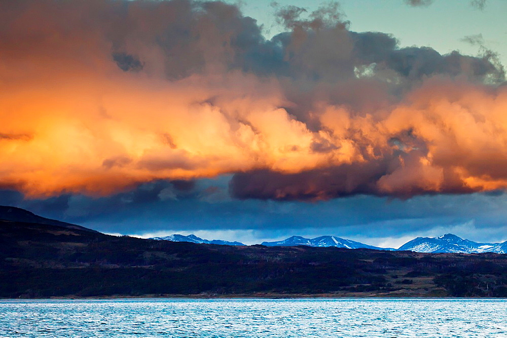 Rain clouds over Beagle Channel at sunset, Tierra del Fuego, Argentina. - 817-278426