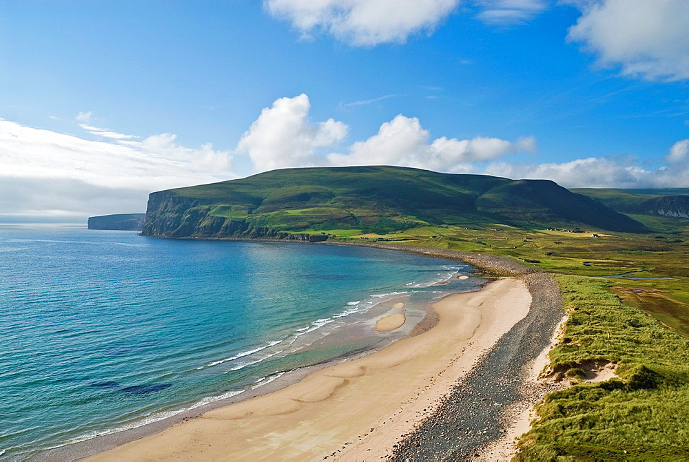Clear waters and green hillsides of Rackwick Bay on the island of Hoy, Orkney Islands, Scotland,
