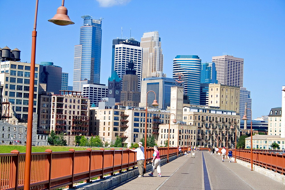 Walkway on the Stone Arch Bridge with a view of downtown Minneapolis skyline Minneapolis Minnesota MN USA