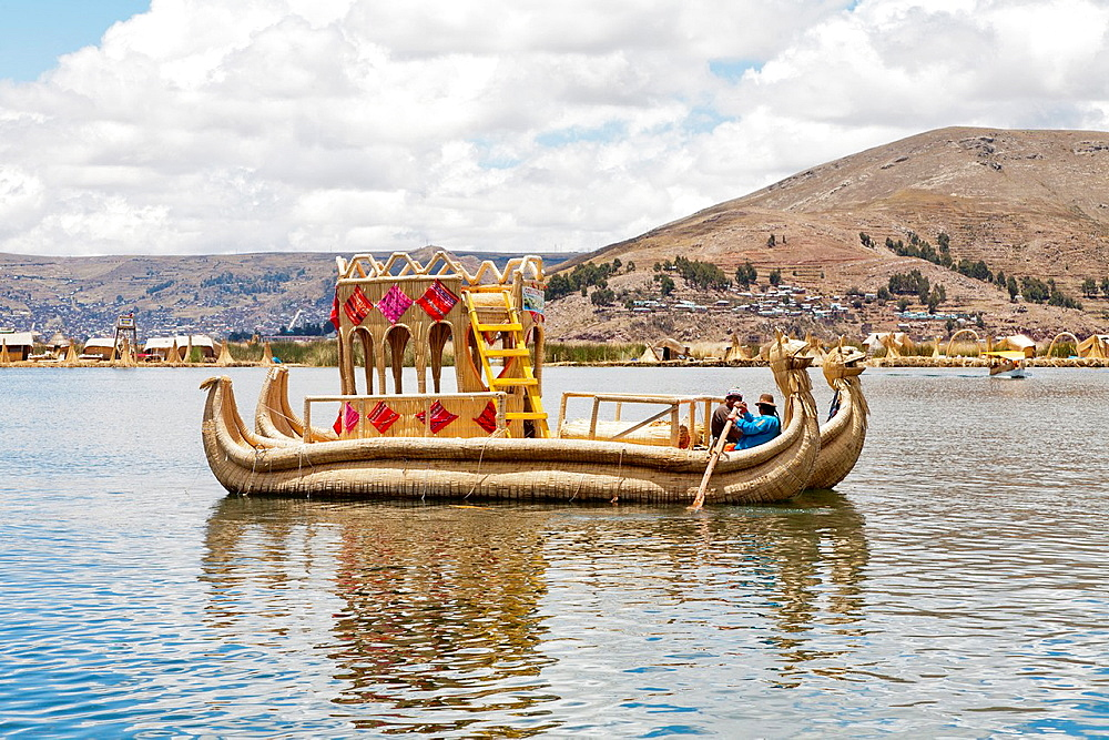 A traditional totora reed boat at the Uros Floating Islands, Lake Titicaca, near Puno, Peru