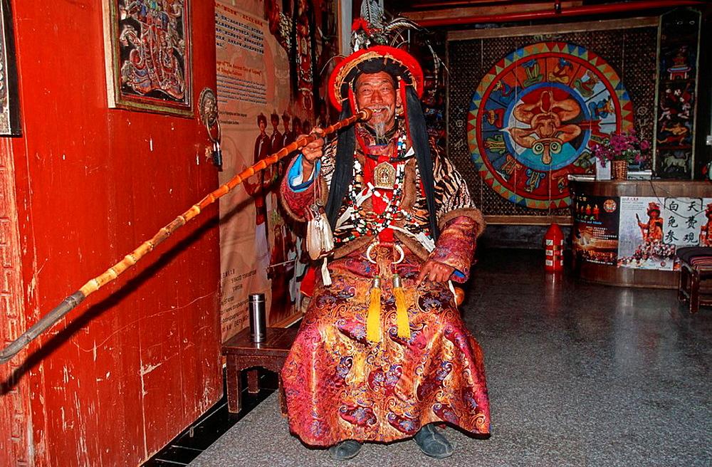 China, Asia, Lijiang, Naxi culture, Shaman Dongba, Traditional, old Dress, costume, smoking Pipe, folklore, man, senio. China, Asia, Lijiang, Naxi culture, Shaman Dongba, Traditional, old Dress, costume, smoking Pipe, folklore, man, senio