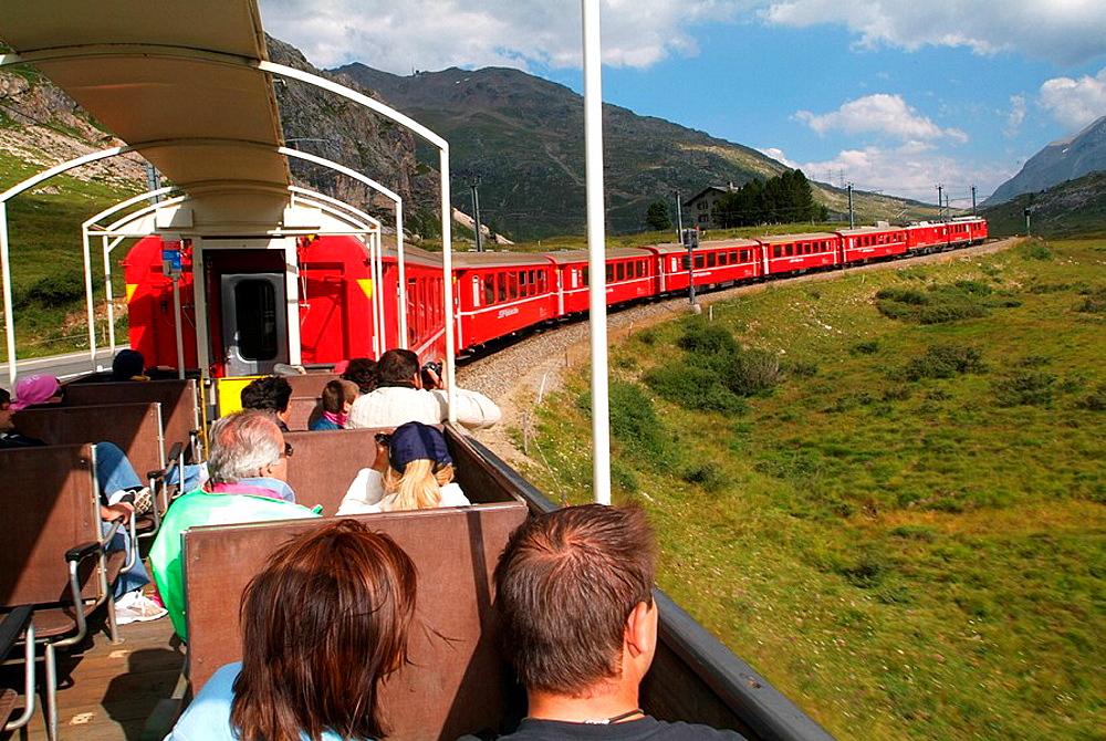 Switzerland, Europe, Canton Grisons, Graubunden, Grisons, Bernina Express, Rhaetian Railway, RhB, train, red, mountain. Switzerland, Europe, Canton Grisons, Graubunden, Grisons, Bernina Express, Rhaetian Railway, RhB, train, red, mountain