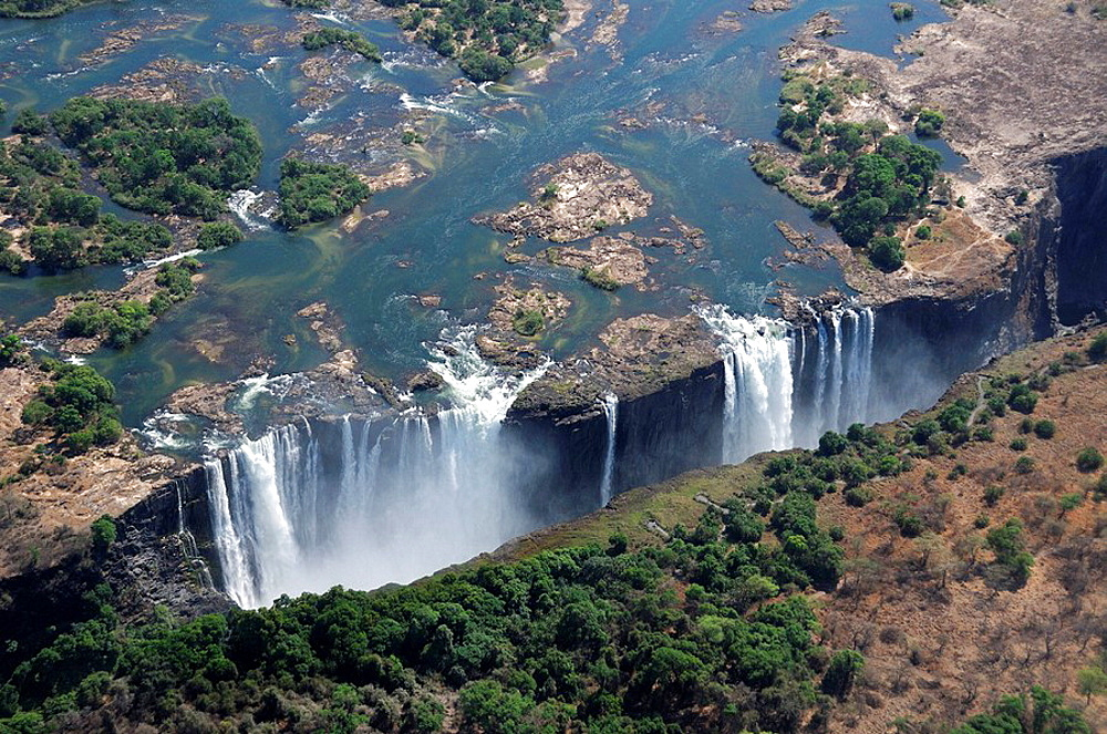 Victoria Falls, Waterfall, waterfalls, Nature, water, rock, cliffs, cliff, Zambesi River, Livingstone, Southern Province, Zambia, Africa, canyon, gorge, landscape, scenery, aerial view. Victoria Falls, Waterfall, waterfalls, Nature, water, rock, cliffs, cliff, Zambesi River, Livingstone, Southern Province, Zambia, Africa, canyon, gorge, landscape, scenery, aerial view